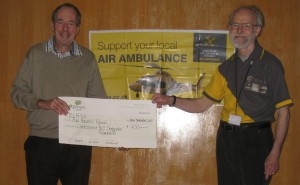 Gordon Blount accepts a cheque on behalf of Derbyshire, Leicestershire, and Rutland Air Ambulance Service at our AGM  (16 November 2013)