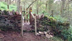 Installed gate, rebuilt wall and restored fence.